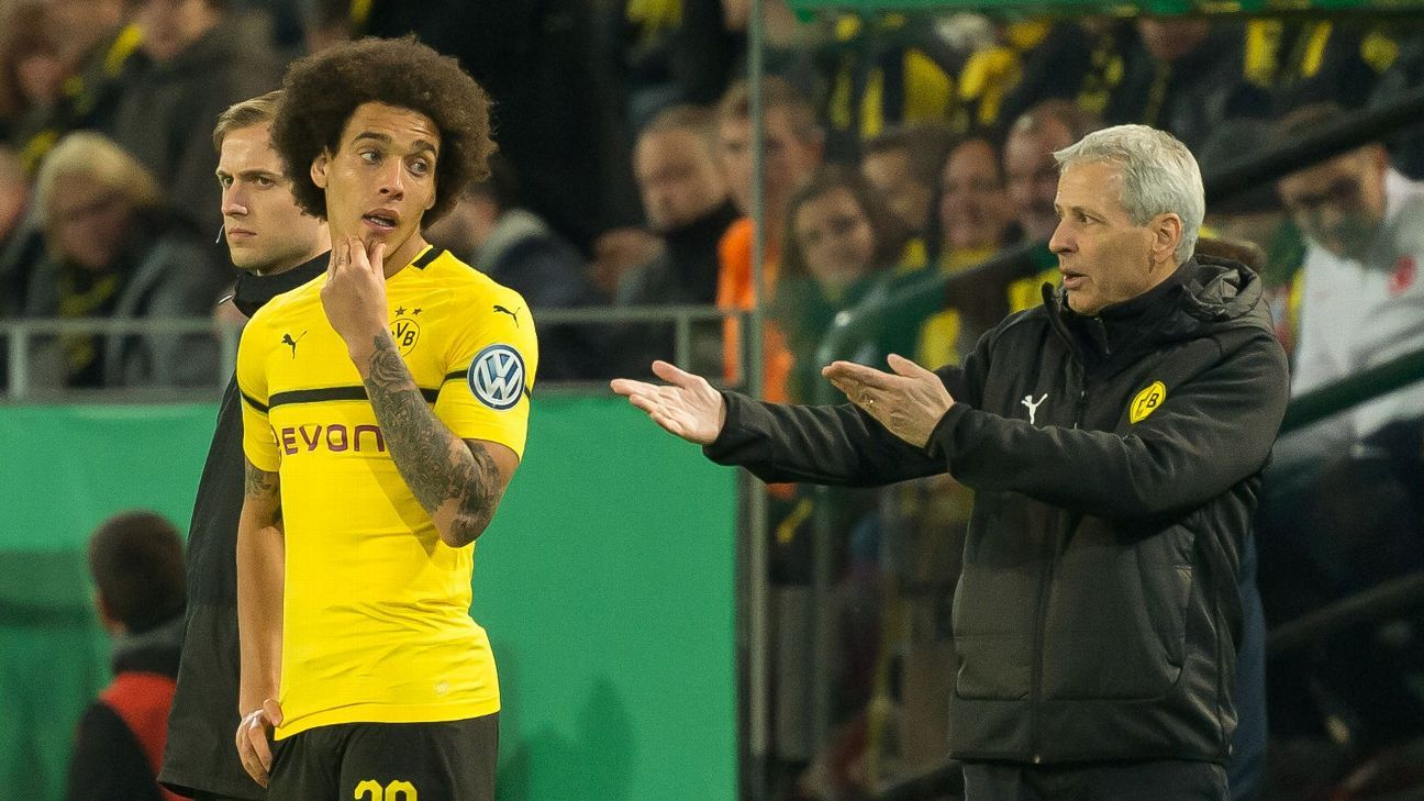 Witsel, left, credits the work of Favre, right, for Dortmund's rapid resurgence and current lead in the Bundesliga.
