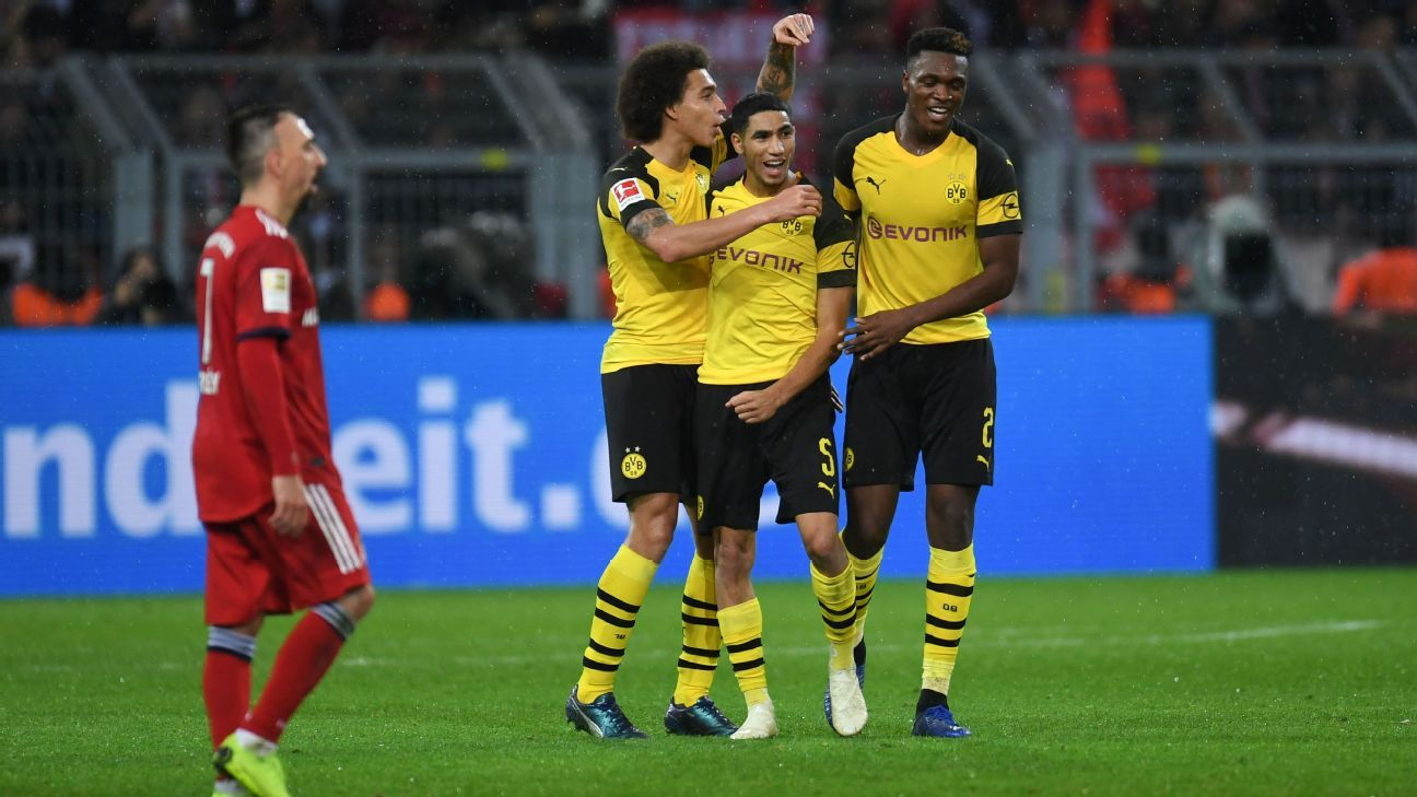 Borussia Dortmund players celebrate during their Bundesliga win over Bayern Munich.