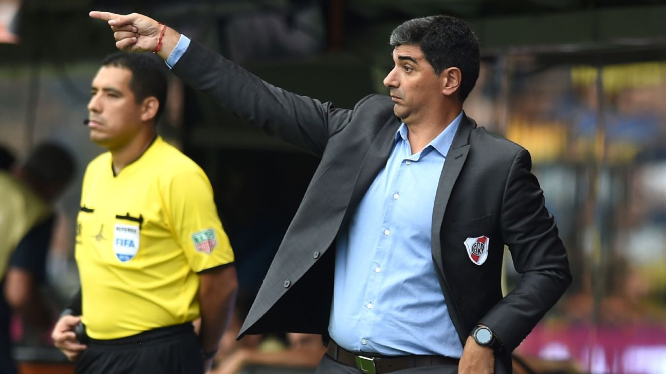 River Plate assistant manager Matias Biscay gives orders to his players