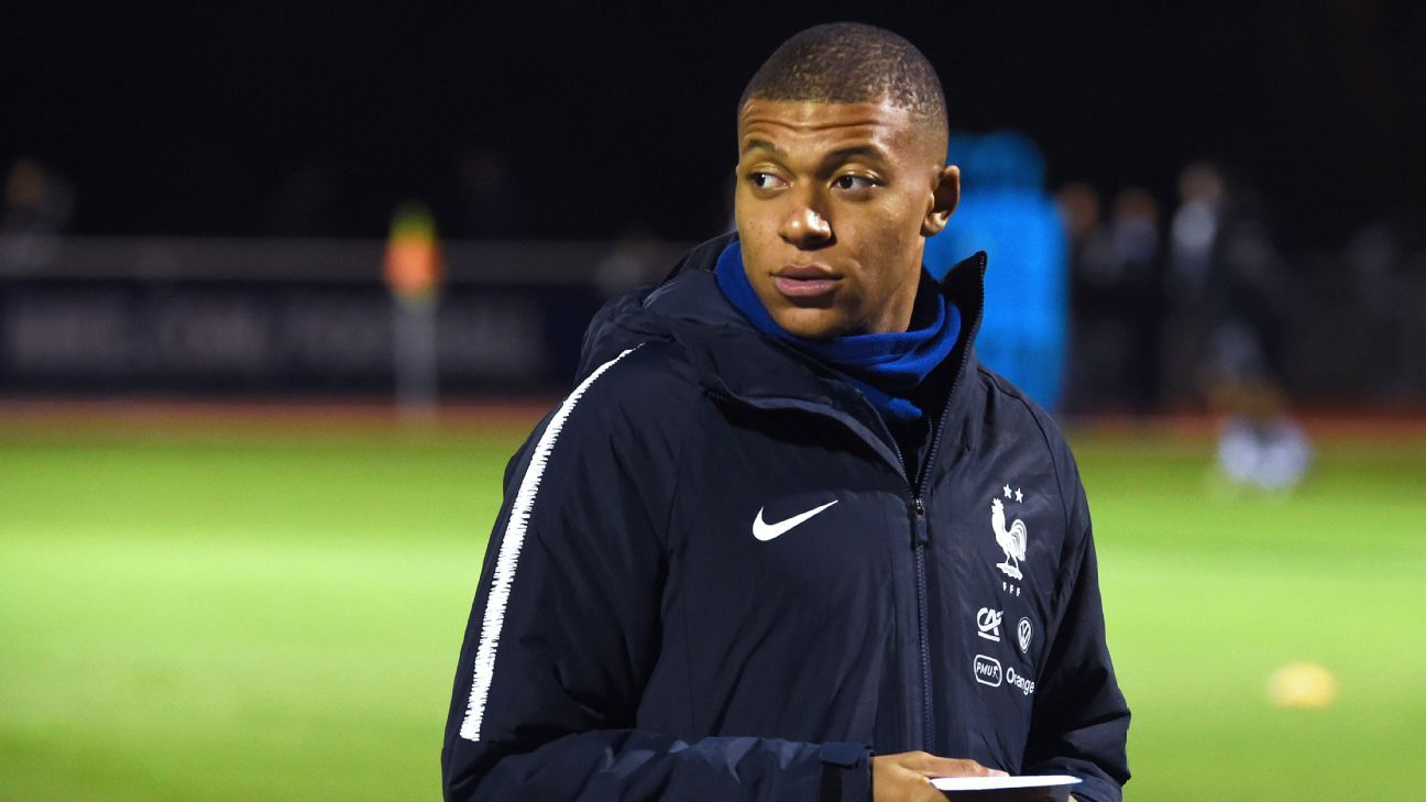 France forward Kylian Mbappe arrives to a training session