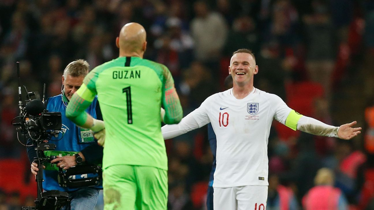 Brad Guzan, left, congratulates Wayne Rooney at the end of a friendly between the U.S. and England.