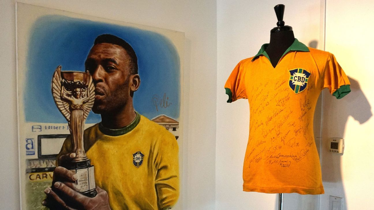 The 1969 Brazil national soccer team signed jersey is displayed next to a painting of Brazilian soccer star Pele.