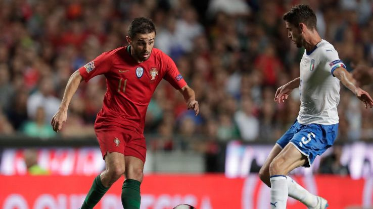 Bernardo Silva and Jorginho vie for the ball during Portugal's Nations League match against Italy.