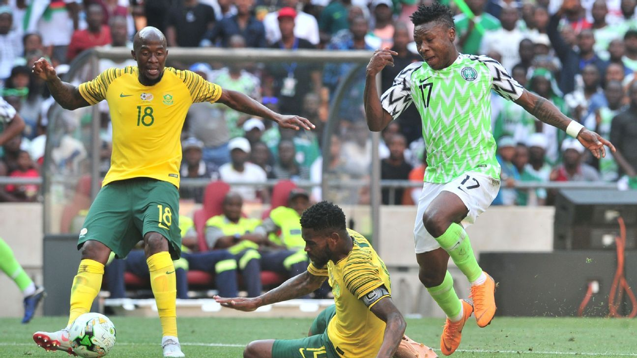Samuel Kalu of Nigeria is challenged by Thulani Hlatshwayo of South Africa