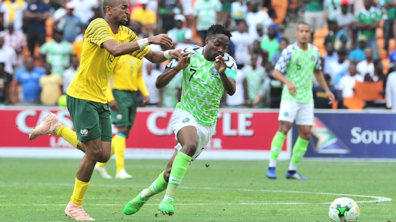 Ahmed Musa of Nigeria is challenged by Tiyani Mabunda of South Africa