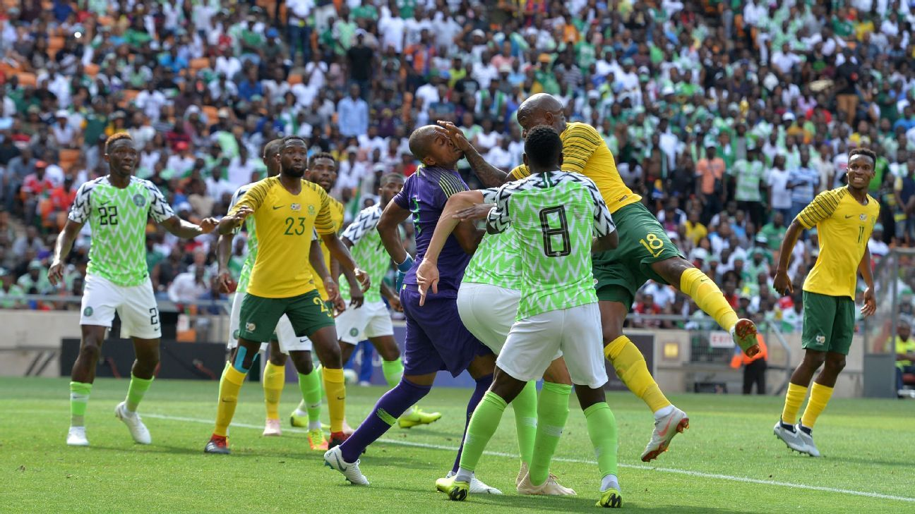 Ikechukwu Ezenwa of Nigeria is challenged by Sifiso Hlanti of South Africa