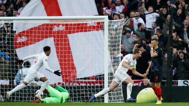 England's striker Harry Kane (R) celebrates after he scores their second goal
