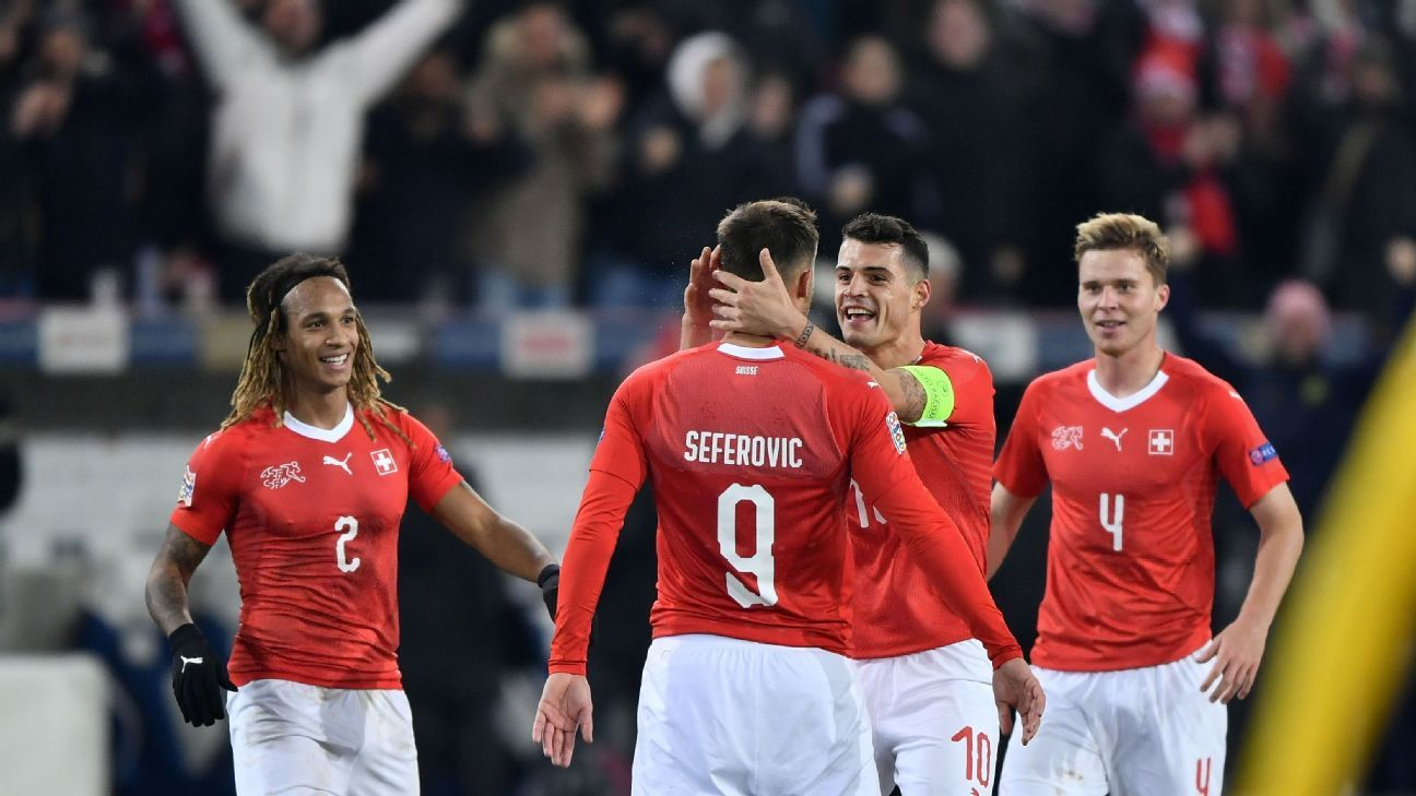 Switzerland players celebrate after scoring a goal against Belgium in the UEFA Nations League