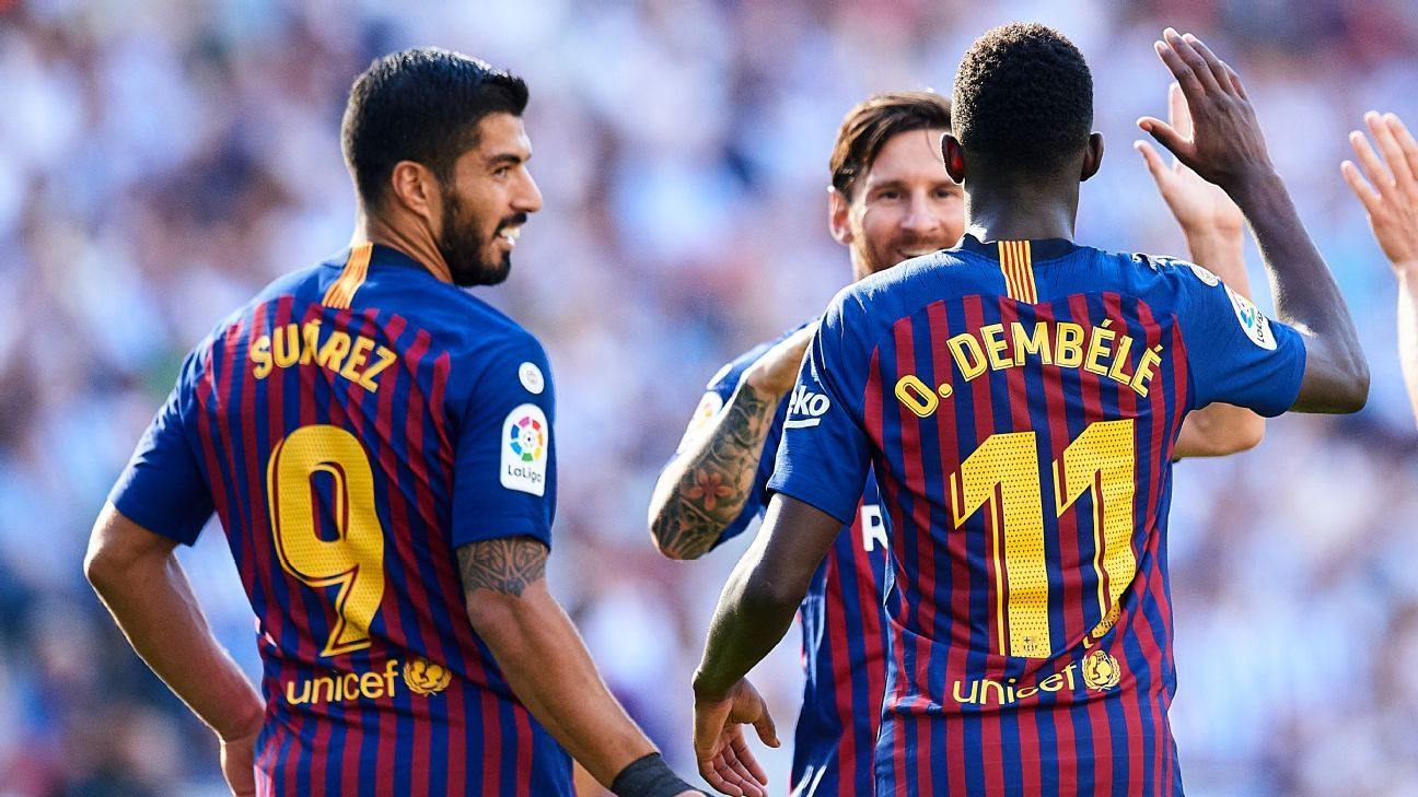 Barcelona teammates Luis Suarez and Ousmane Dembele celebrate with Lionel Messi