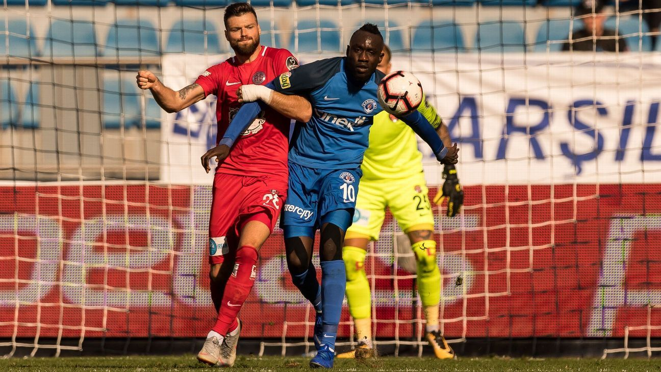 Kasimpasa striker Mbaye Diagne, centre, battles for the ball during a Turkish Super Lig match.