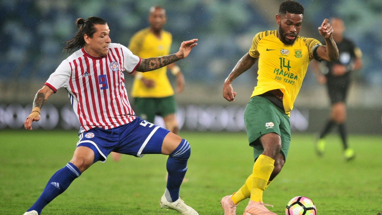 Thulani Hlatshwayo (R) of South Africa in action with Federico Santander of Paraguay
