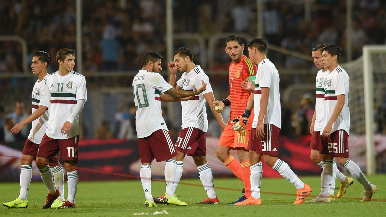 Mexico players react after an Argentina goal in a friendly in Mendoza.
