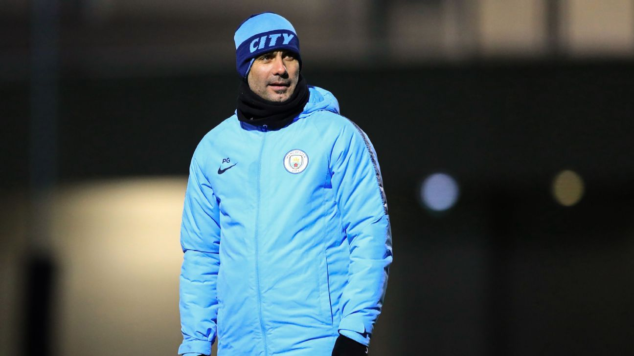 Manchester City manager Pep Guardiola looks on during a training session