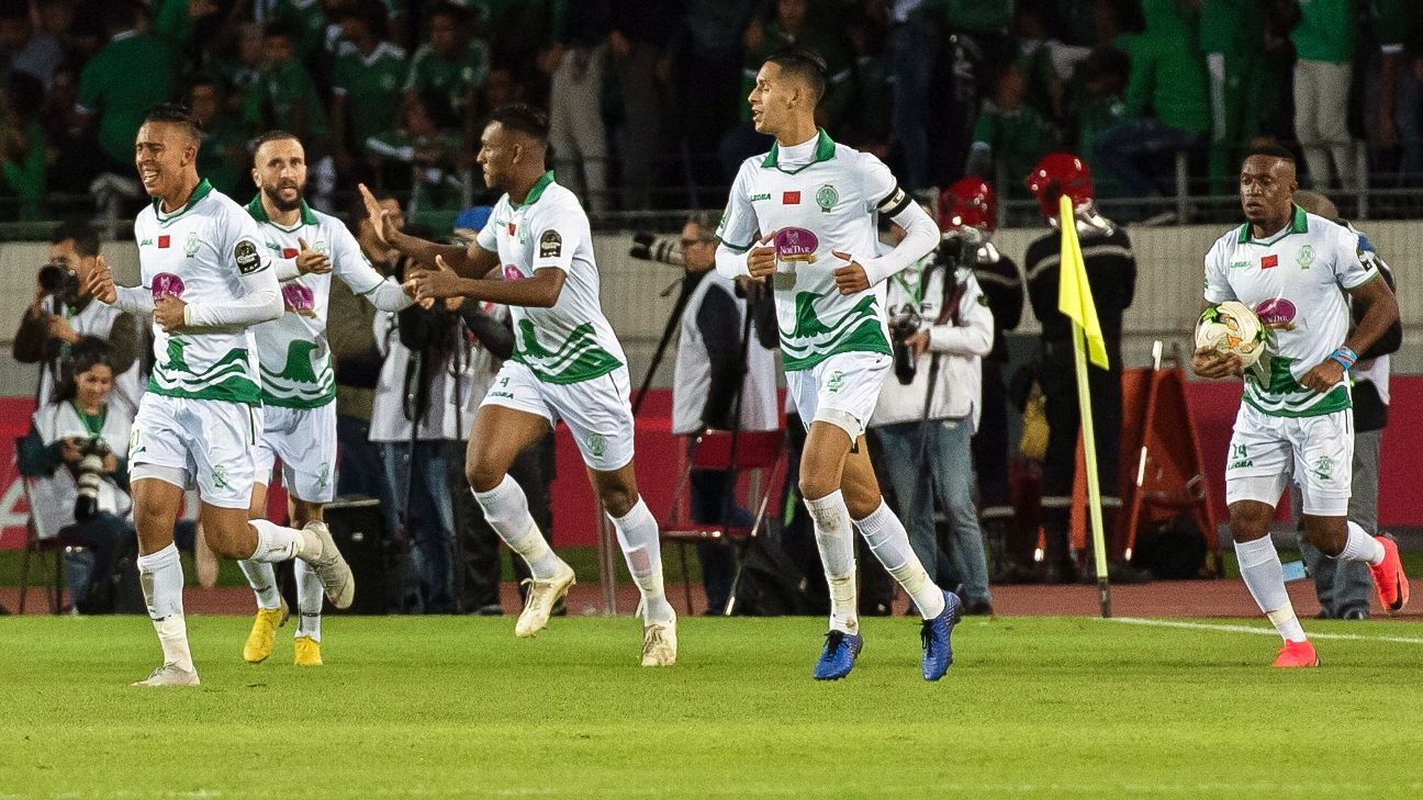 Raja Casablanca players celebrate a goal un their  CAF Confederation Cup final first leg against AS Vita.