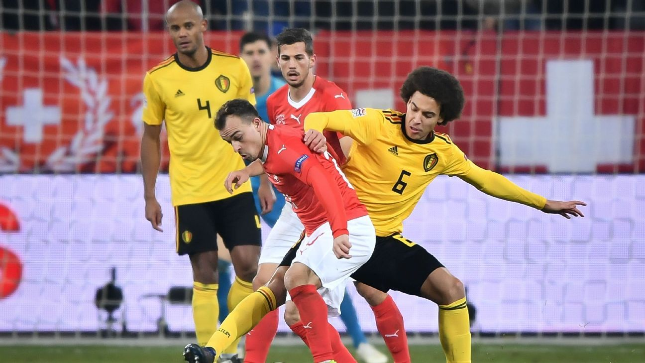 Axel Witsel battles for the ball with Xherdan Shaqiri during the UEFA Nations League clash between Switzerland and Belgium