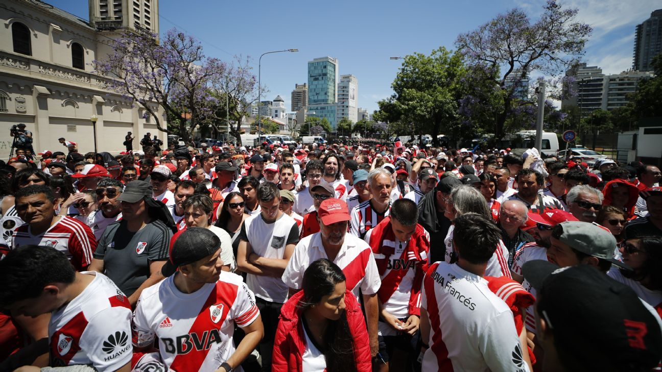 River Plate supporters wait outside the stadium ahead of the Copa Libertadores final second leg which was eventually postponed.