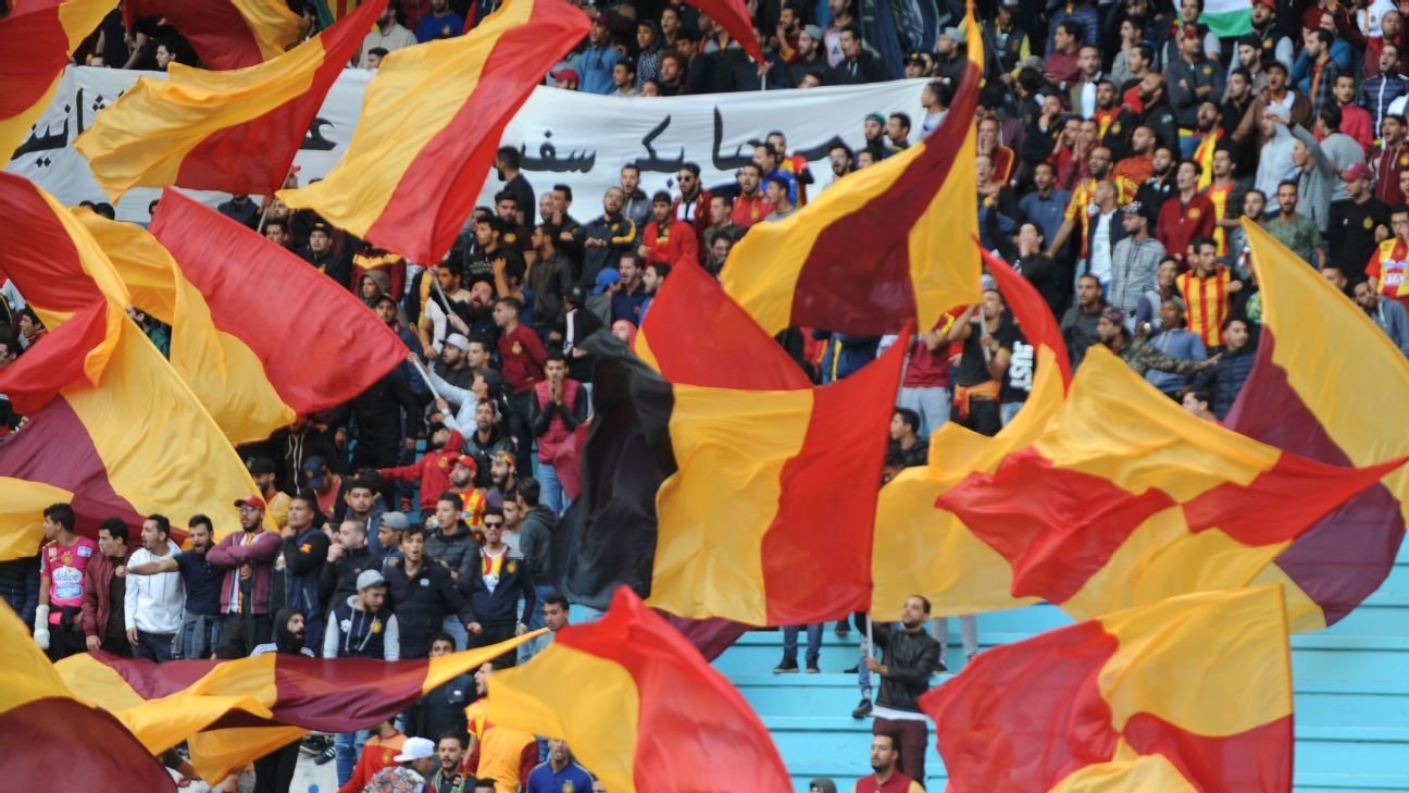 Fans of Esperance cheer their team on