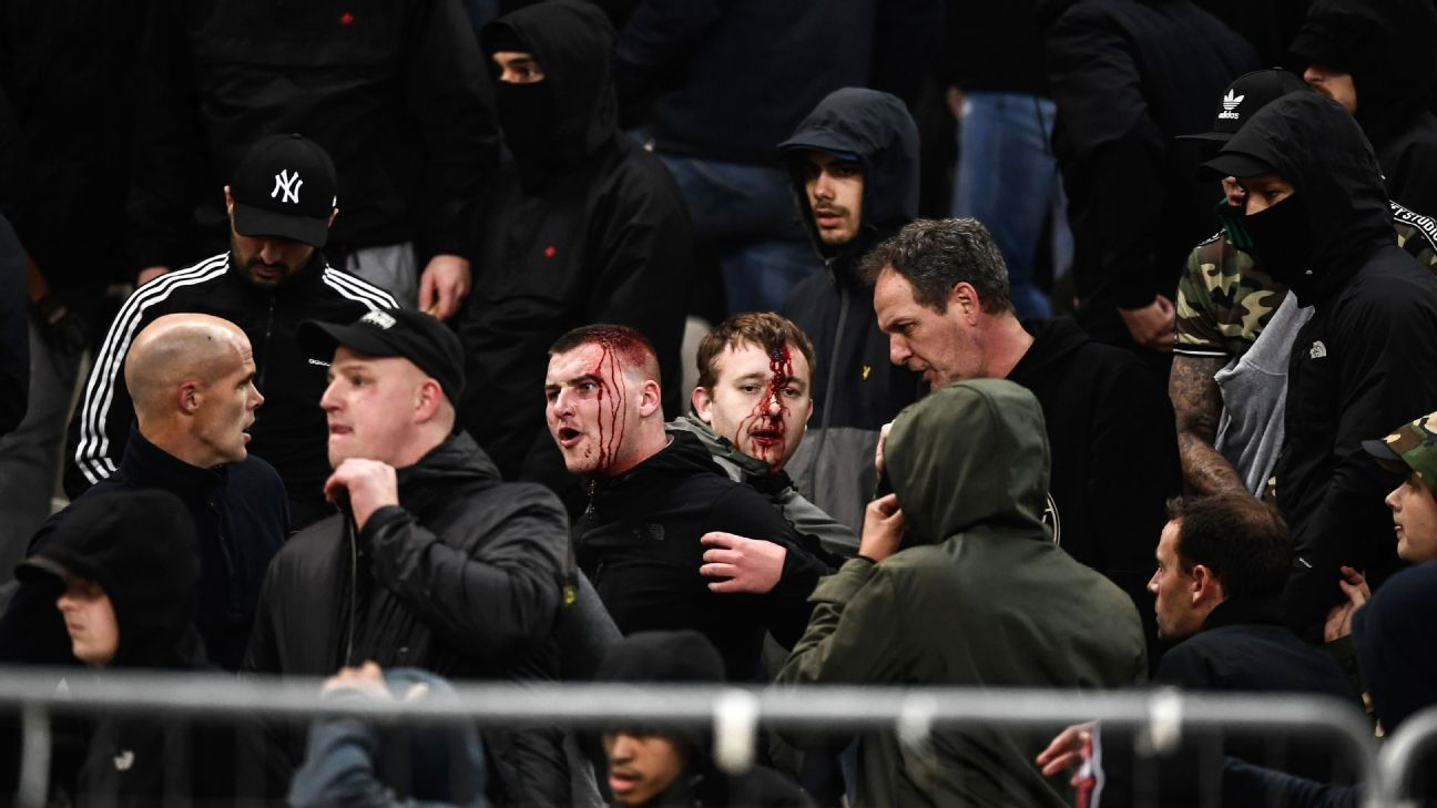 Ajax fans react after clashing with Greek riot police ahead of kick-off between Ajax and AEK Athens.