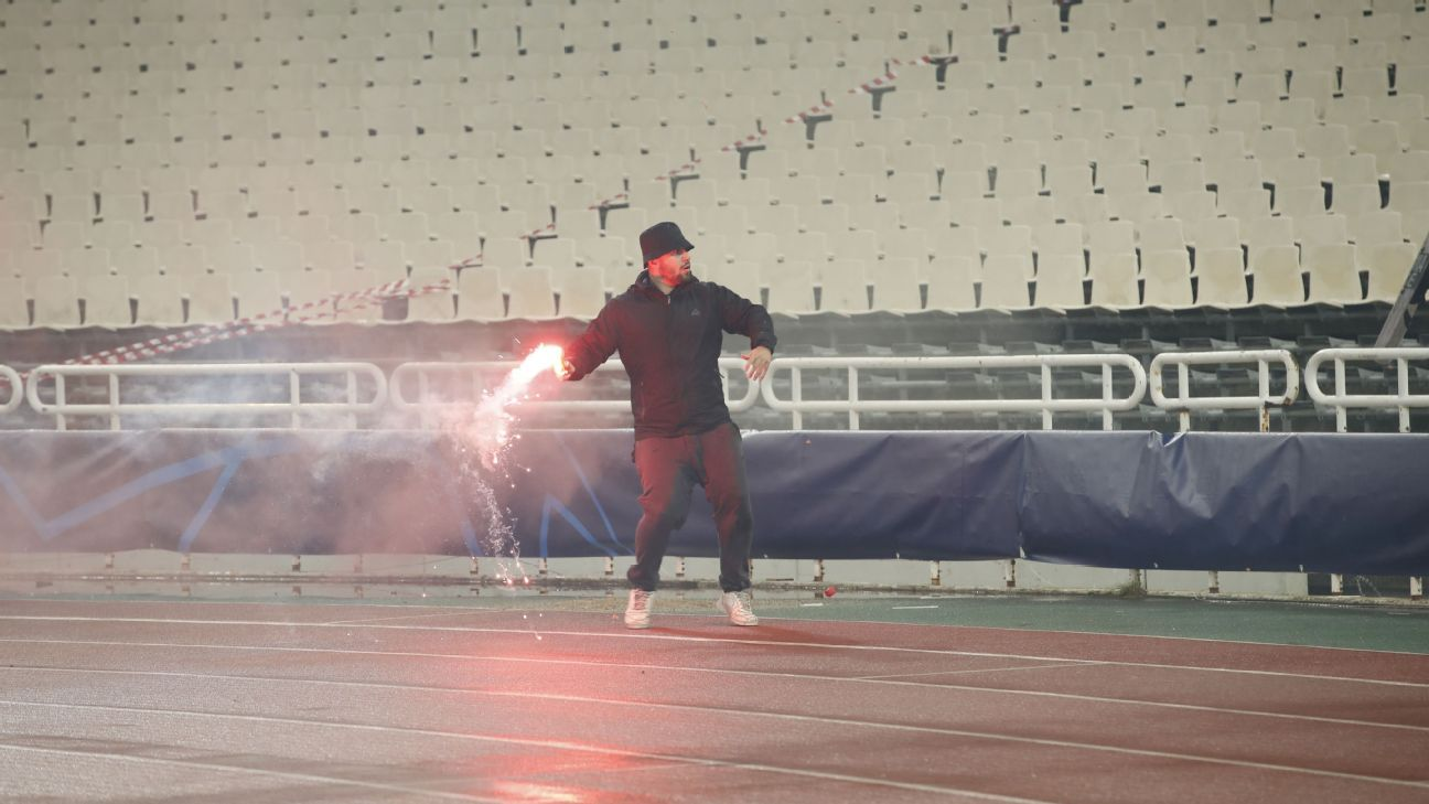An AEK fan reportedly threw fireworks into the Ajax supporter section ahead of Tuesday's kick-off.