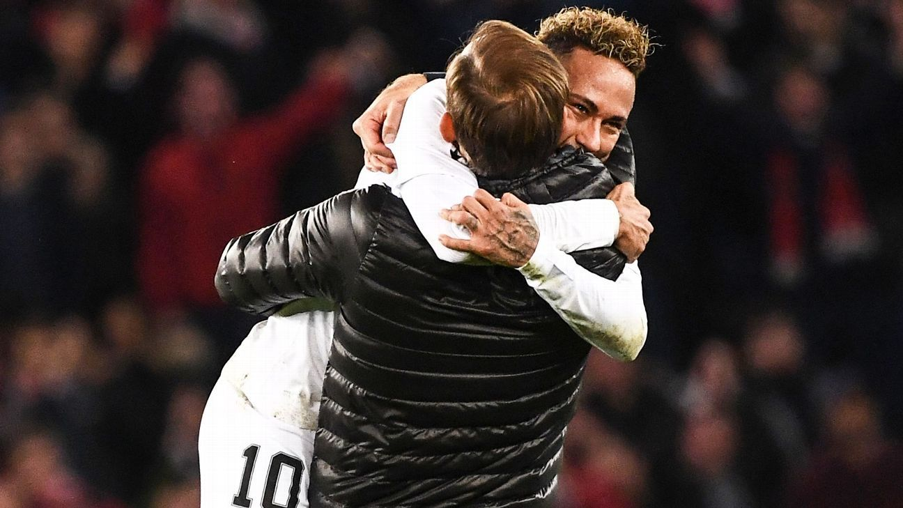 Paris Saint-Germain's Brazilian forward Neymar celebrates with Paris Saint-Germain's German coach Thomas Tuchel after winning  at the end of the UEFA Champions League Group C football match between Paris Saint-Germain (PSG) and Liverpool FC at the Parc de