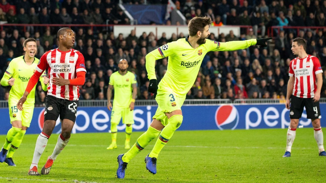 Gerard Pique points to Lionel Messi after scoring a goal for Barcelona in the Champions League.