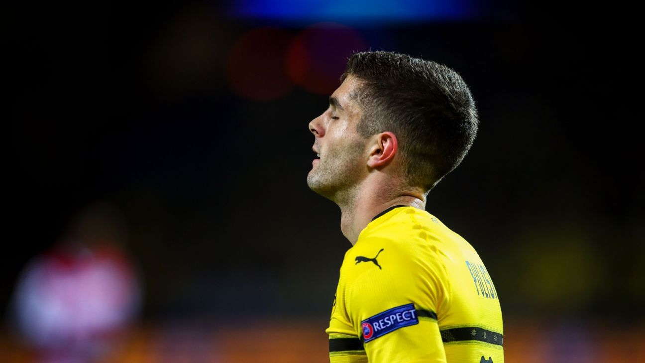 Christian Pulisic reacts after missing a shot during Borussia Dortmund's Champions League match against Club Brugge.
