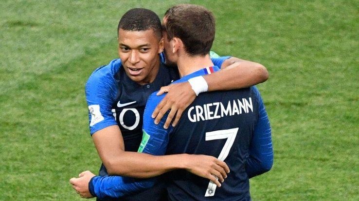 Kylian Mbappe celebrates a goal with France's teammate Antoine Griezmann