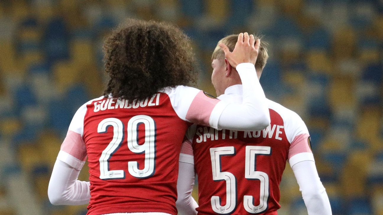 Arsenal's Emile Smith Rowe, right, celebrates with Matteo Guendouzi after scoring against Vorskla.