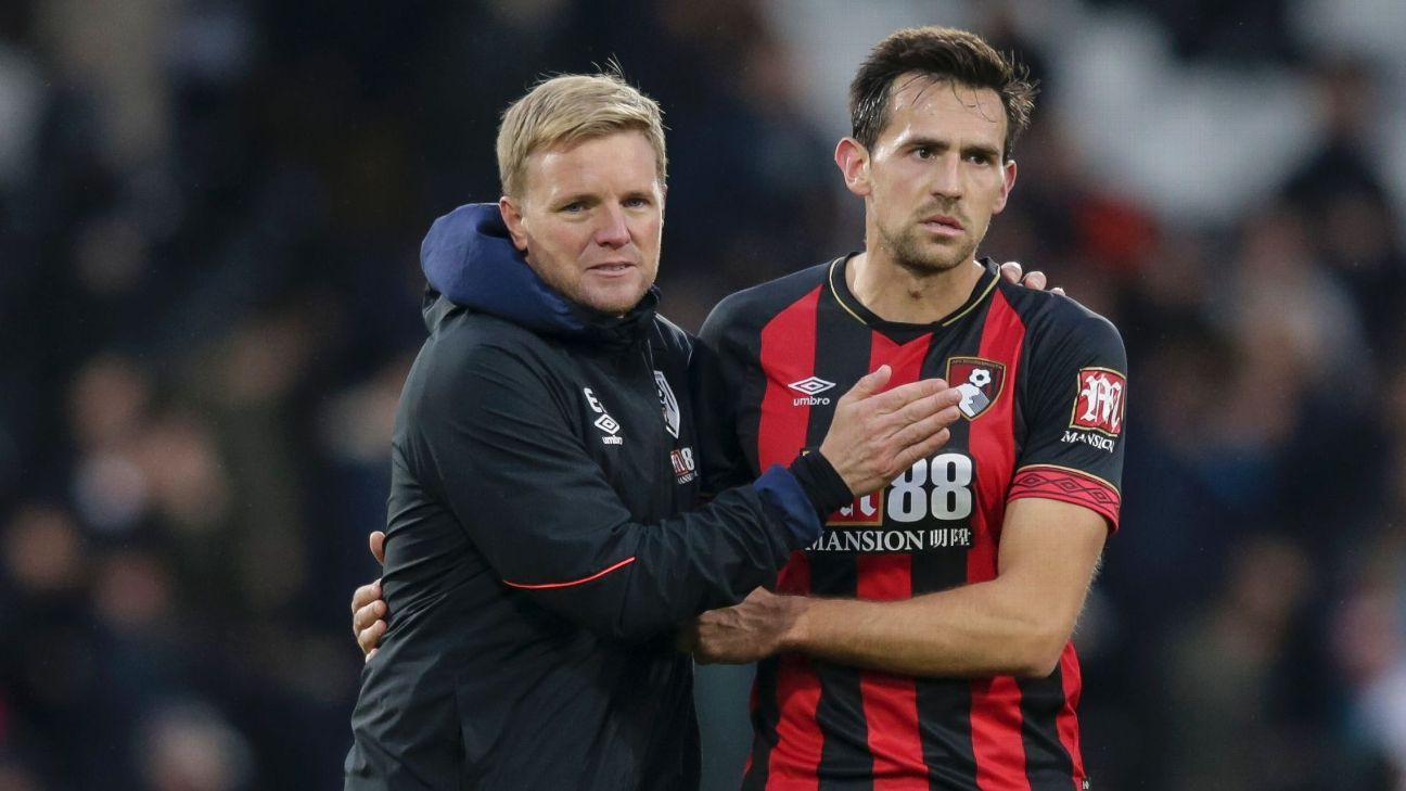 Eddie Howe, left, and Charlie Daniels leave the pitch after Bournemouth's 3-0 win against Fulham in October.