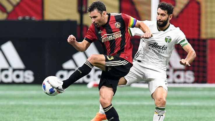 Michael Parkhurst and Diego Valeri vie for the ball during the MLS match between Atlanta United and the Portland Timbers.