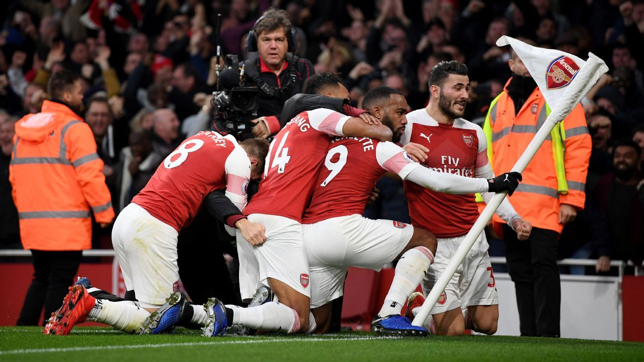 Alexandre Lacazette of Arsenal celebrates with teammates after scoring his team's third goal