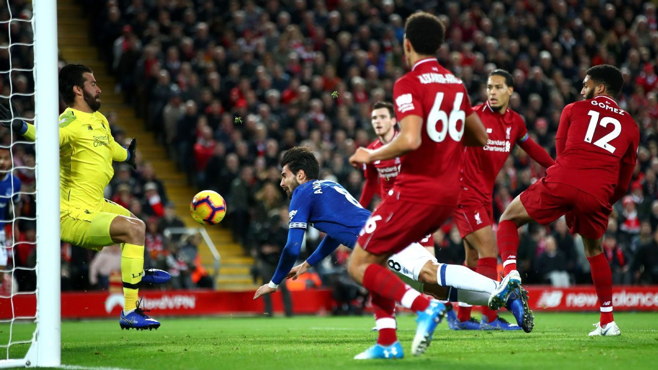 Alisson, left, made a string of stunning saves to keep Everton out, setting the tone for Liverpool's dramatic late win.