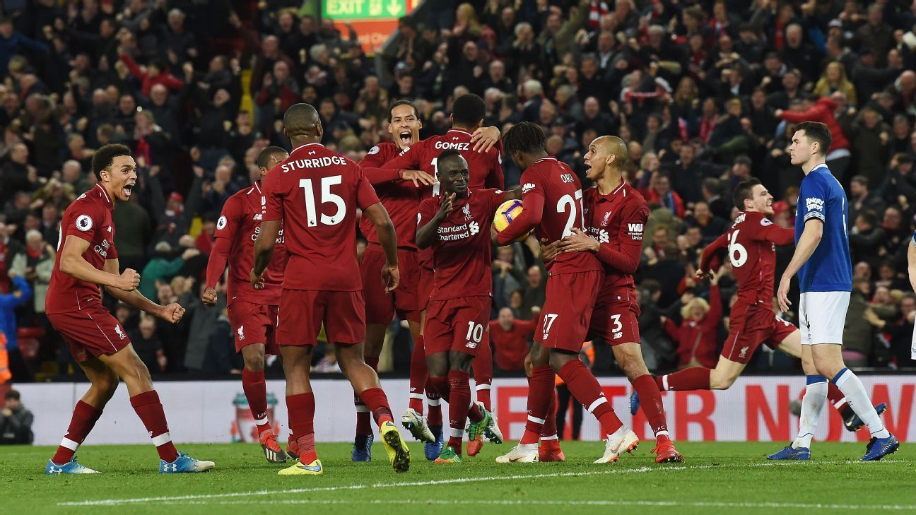 Liverpool celebrate after Divock Origi's last-minute goal handed them victory in one of the wildest Merseyside derby finishes ever.