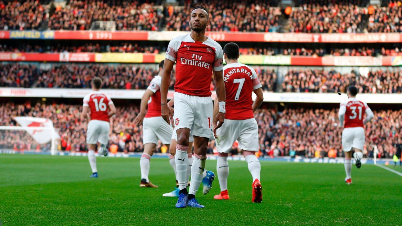 A banana thrown from the crowd is seen at the side of the pitch as Pierre-Emerick Aubameyang celebrates a goal for Arsenal