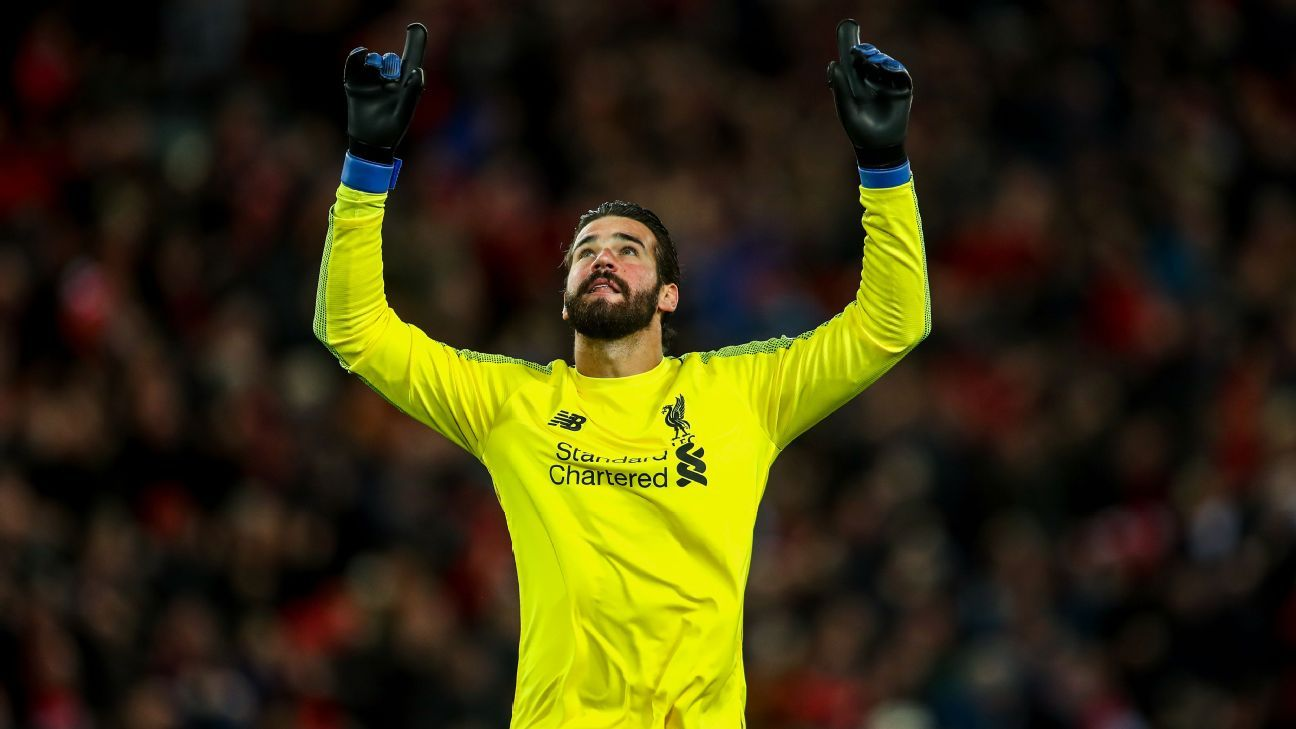 Alisson celebrates after Liverpool's Premier League win over Everton.