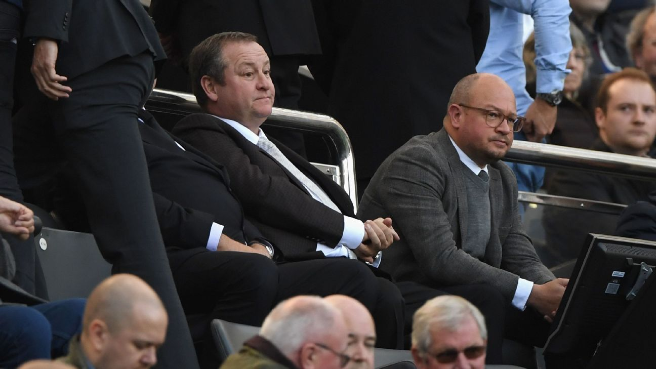 Newcastle owner Mike Ashley, centre, looks on during his team's Premier League match against Leicester.