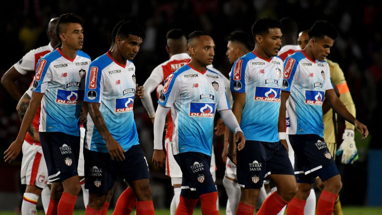 Players of Atletico Junior leave the field at the end of a first-leg win against Independiente Santa Fe Copa Sudamericana semis.