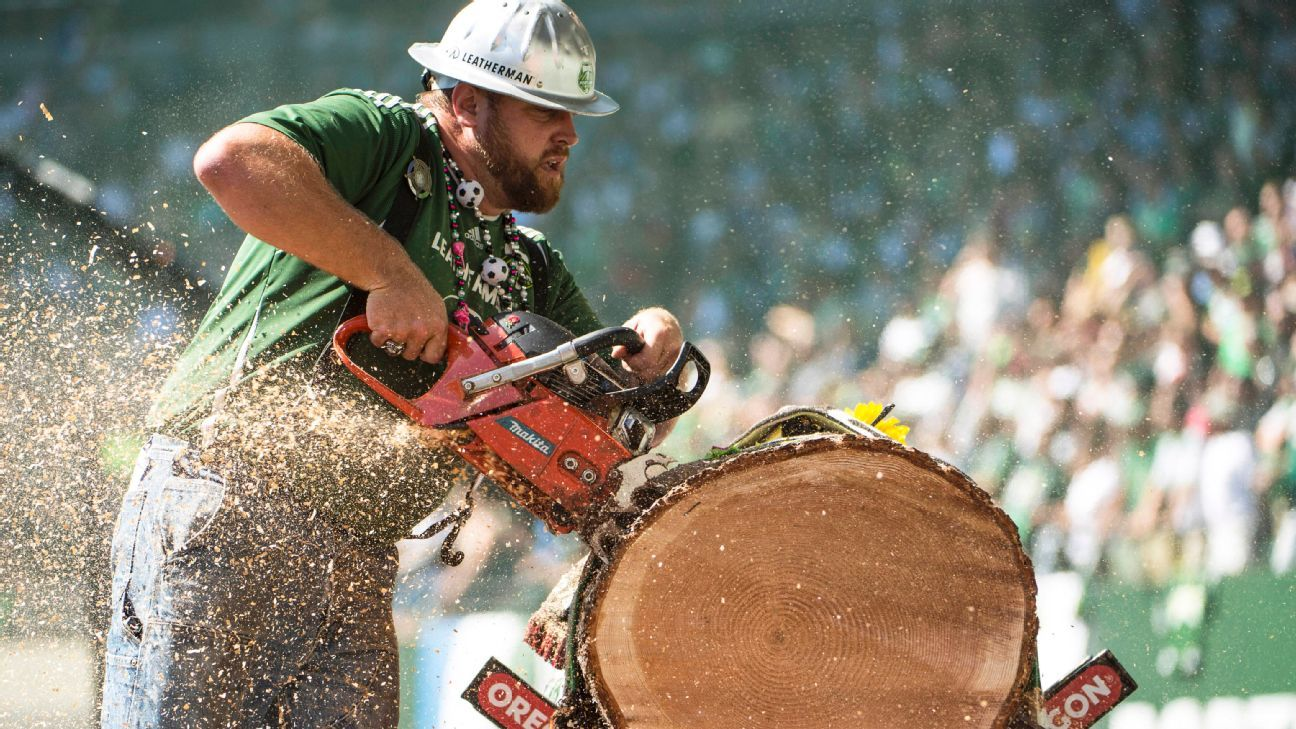 Timber Joey cuts a piece of timber during the Portland Timbers' MLS match against the Seattle Sounders.