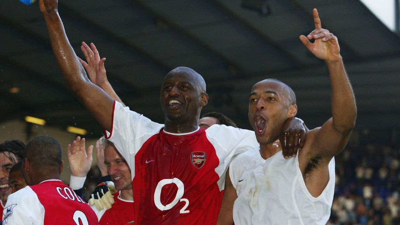 Patrick Vieira and Thierry Henry celebrate after Arsenal's Premier League match against Tottenham.