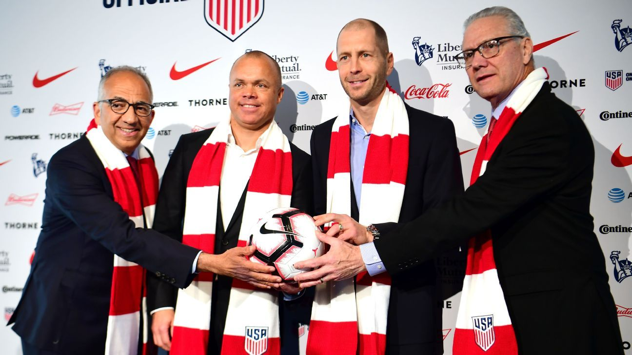 U.S. Soccer president Carlos Cordeiro, national team general manager Earnie Stewart, head coach Gregg Berhalter, and CEO Dan Flynn pose for a photo after a press conference to introduce Berhalter as U.S. men's national team manager.