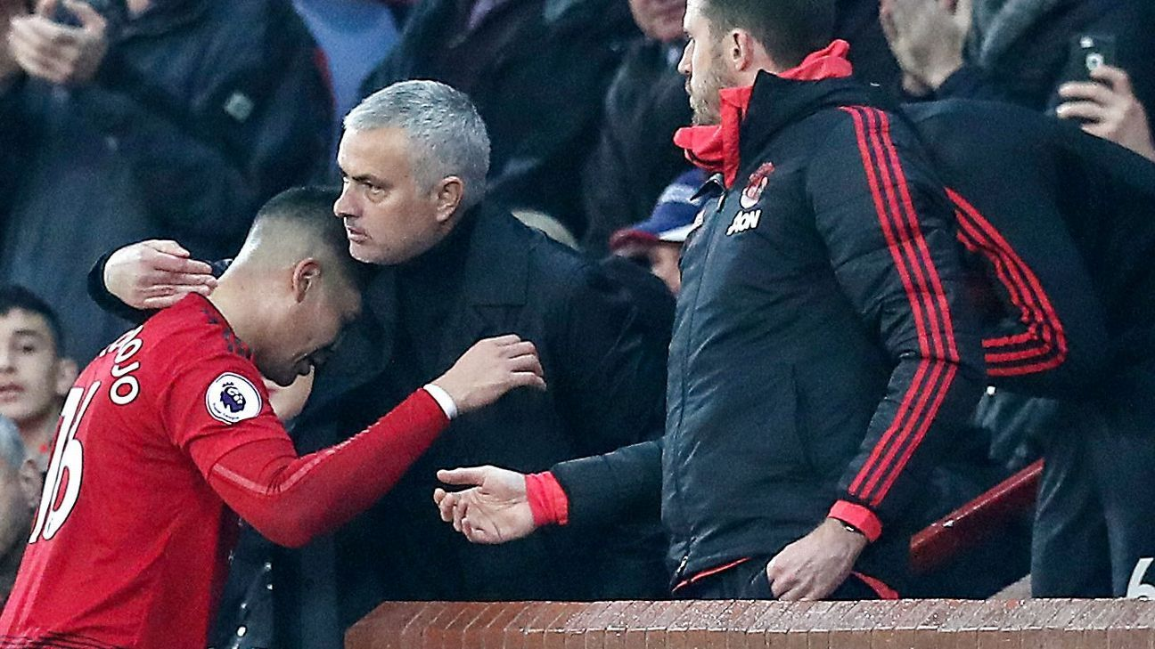 Manchester United's Marcos Rojo embraces manager Jose Mourinho during the Premier League match at Old Trafford, Manchester.