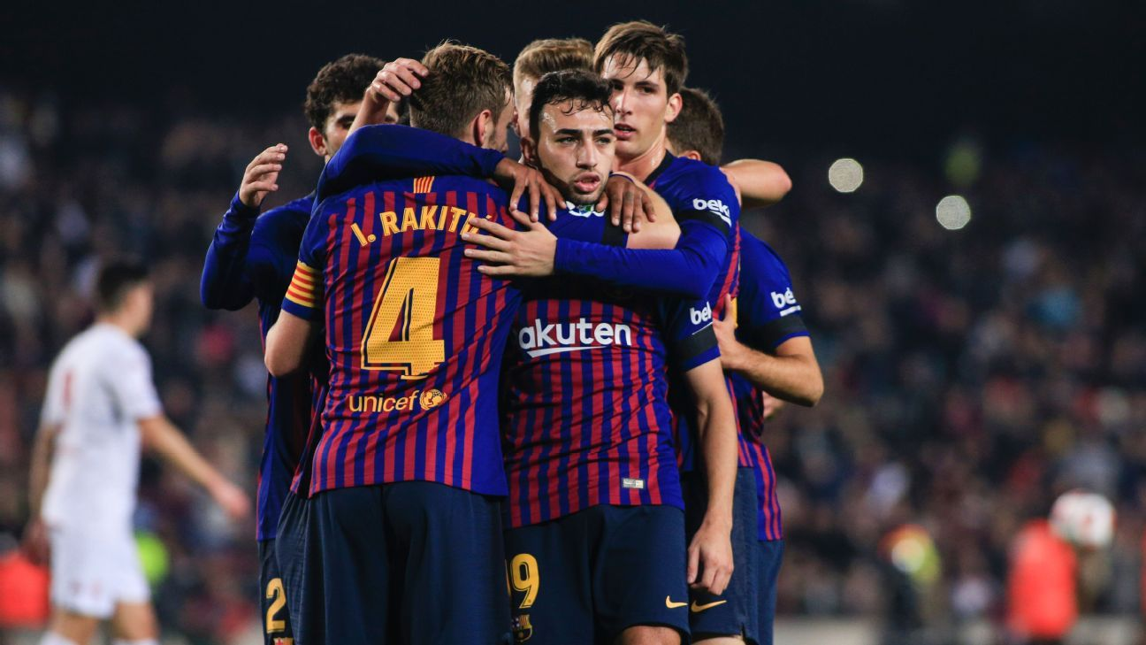 Barcelona players celebrate after scoring a goal against Cultural Leonesa in the Copa del Rey.