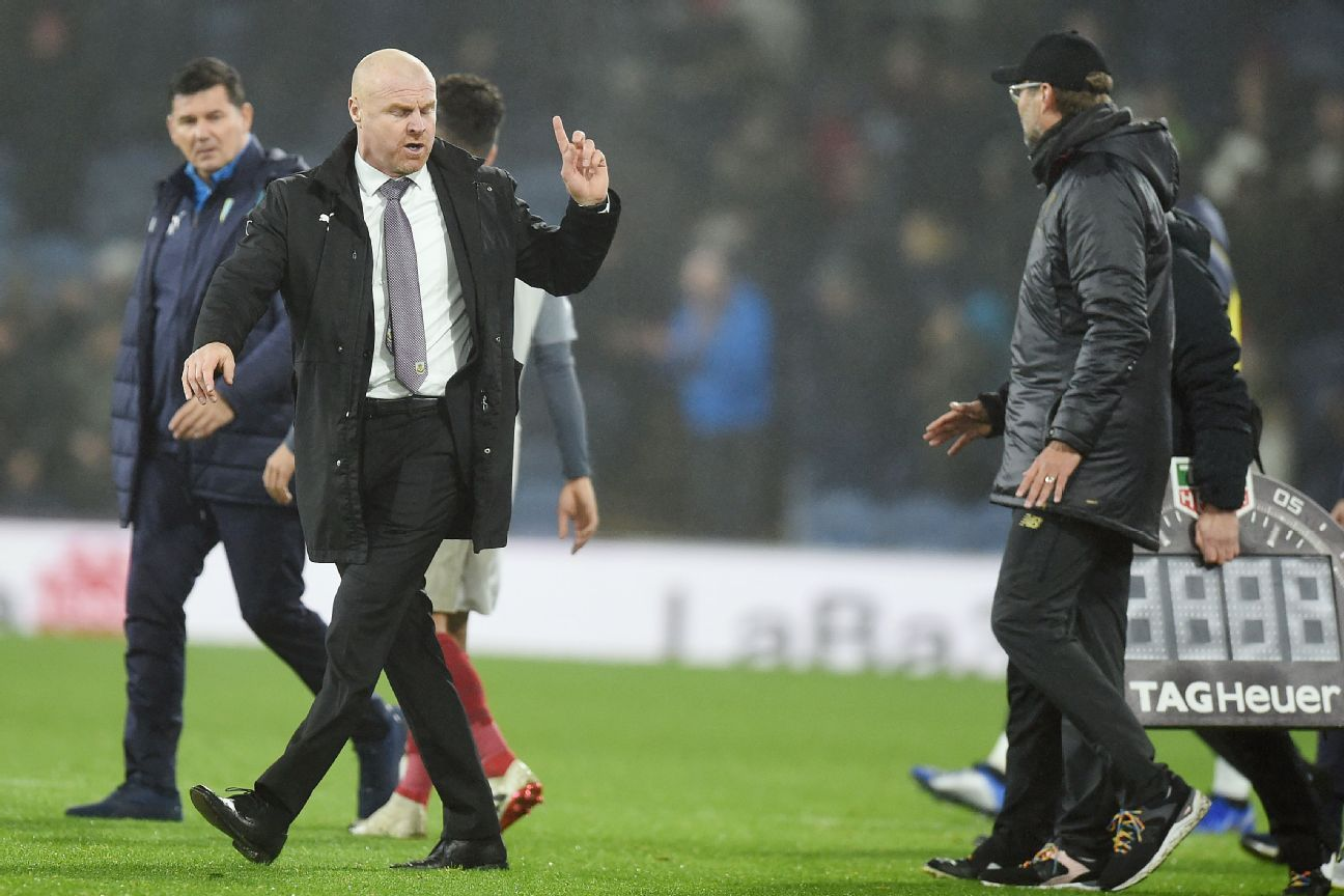 Burnley manager Sean Dyche, left, and Liverpool boss Jurgen Klopp exchange words at the end of their Premier League match.