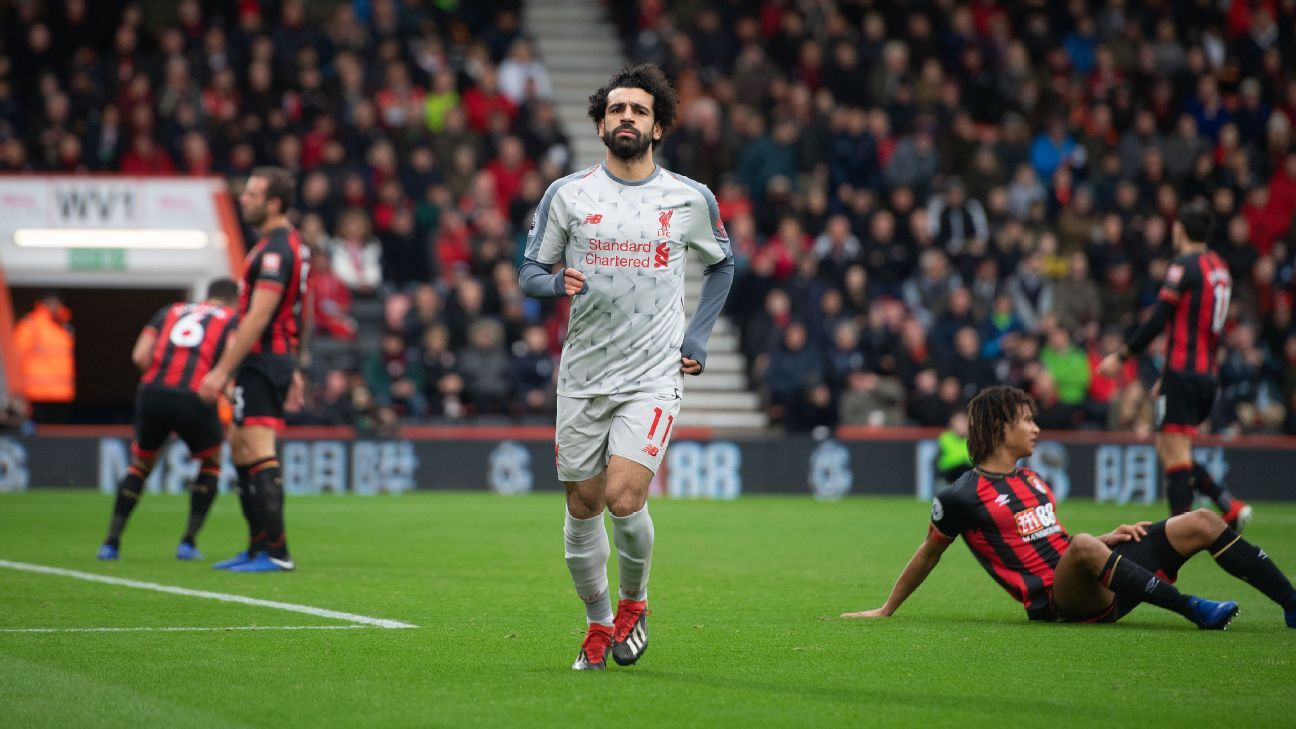 Mohamed Salah wheels away after a second goal for Liverpool in their Premier League game against Bournemouth.