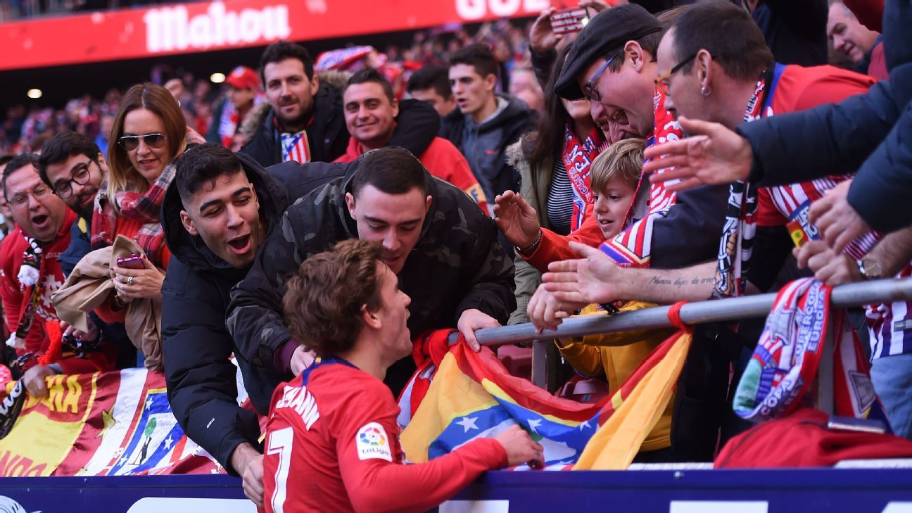 Antoine Griezmann celebrates with Atletico Madrid fans after scoring against Alaves.