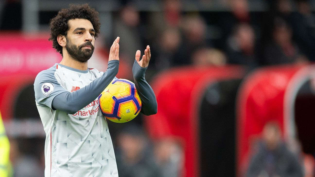Mohamed Salah claimed the match ball after scoring three times against Bournemouth in Liverpool's 4-0 win.