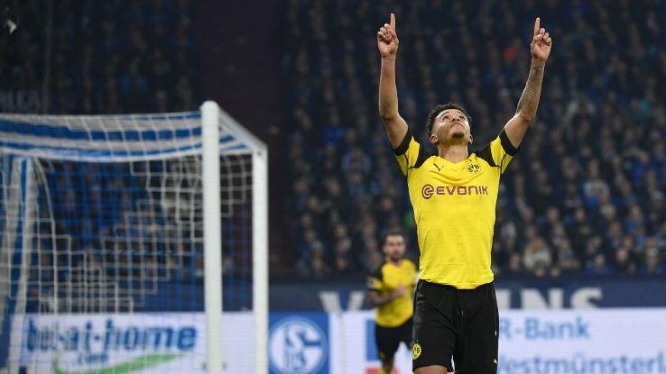 Jadon Sancho celebrates his goal for Borussia Dortmund against local rivals Schalke.