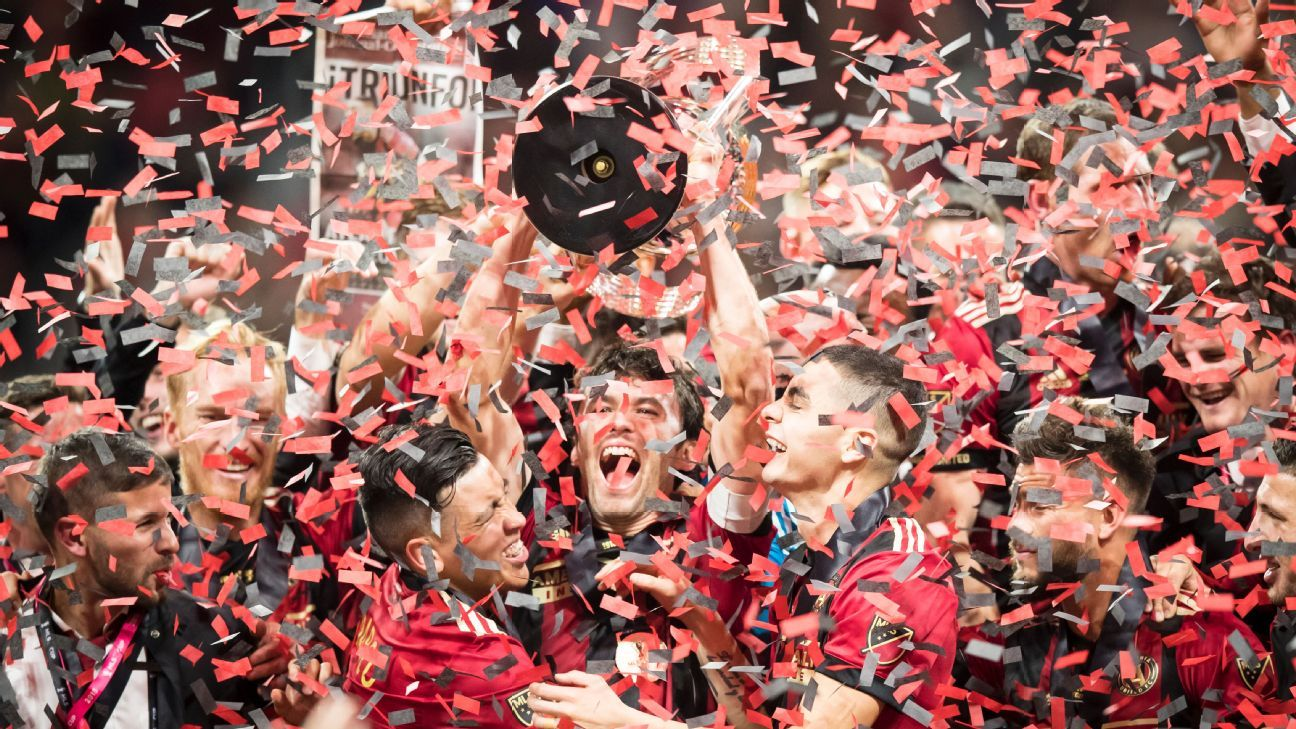 Michael Parkhurst lifts the MLS Cup, the city of Atlanta's first major pro sports trophy in over 20 years