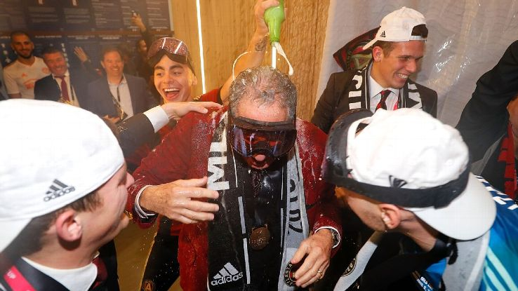Atlanta United owner Arthur Blank got doused in beer after the team's MLS Cup win