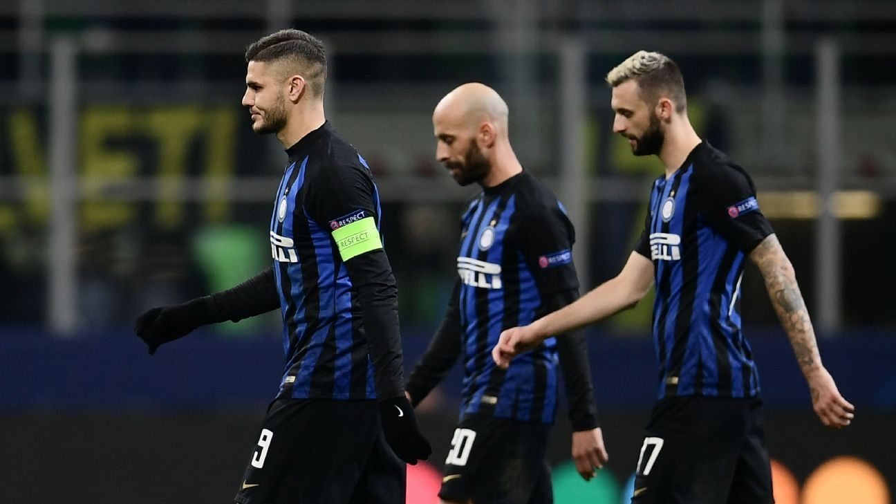 Mauro Icardi, left, walks off the field with Inter Milan teammates after being eliminated from the Champions League.